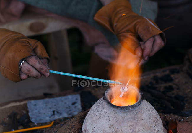 Cropped view of glassblower hands holding tools — Stock Photo