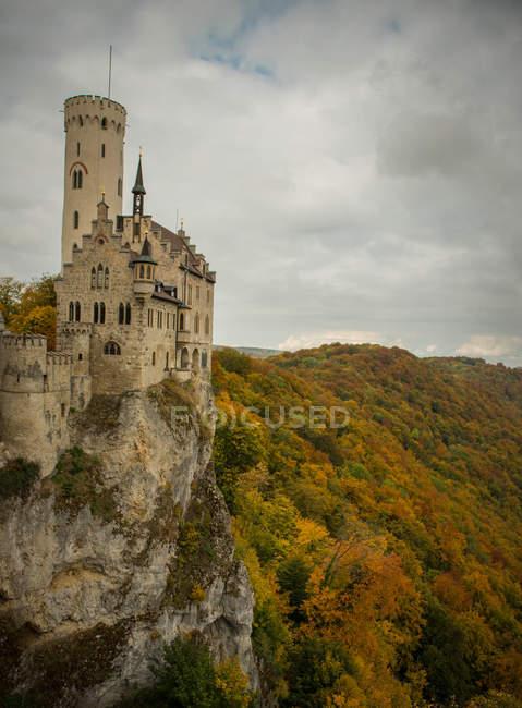 Castle Lichtenstein and autumn tress on hills — Stock Photo
