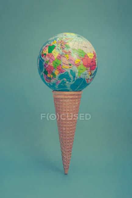 Creative composition made with waffle cone and earth globe, ice cream — Stock Photo