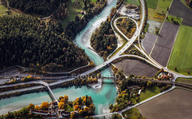 Scenic aerial view on landscape with river and roads