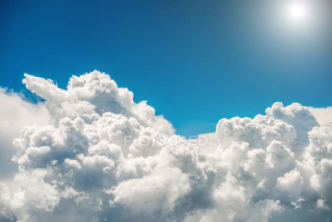 White clouds, bright sun — Stock Photo