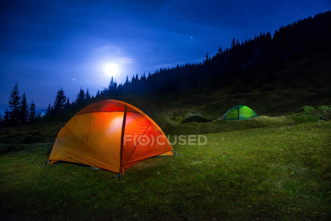 Camping tents under moon — Stock Photo