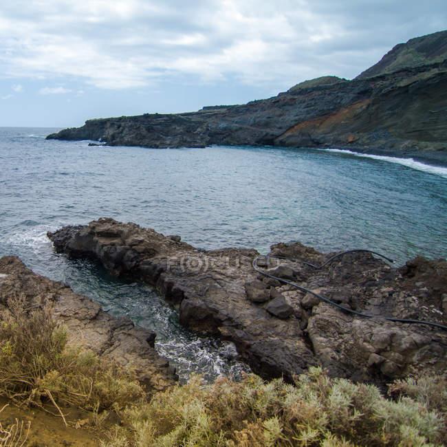 Rocky coastline in moody light — Stock Photo