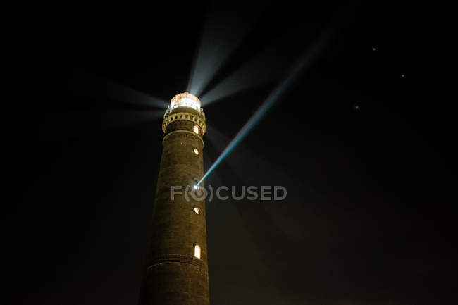 Lighthouse view and light beam — Stock Photo