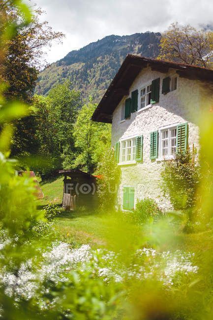 Dream house in mountains with dream house in mountains — Stock Photo