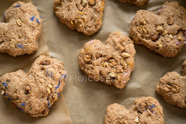 Heart shaped cookies with seeds — Stock Photo