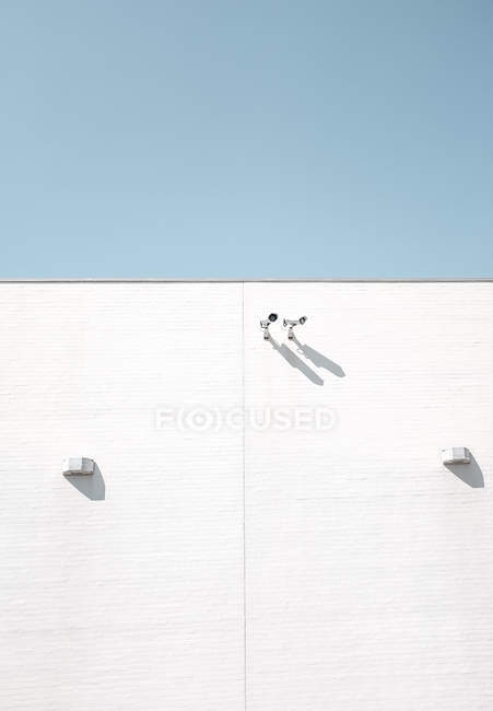 Security security on white building wall — Stock Photo