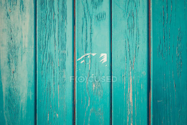 Daytime view of green painted wooden planks — Stock Photo