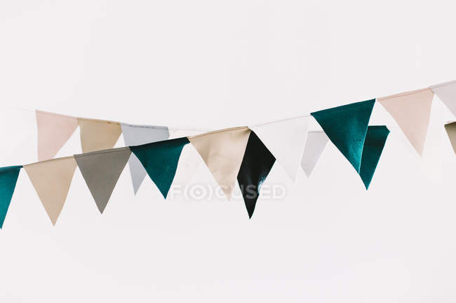 Different colored flags hanging on two ropes — Stock Photo