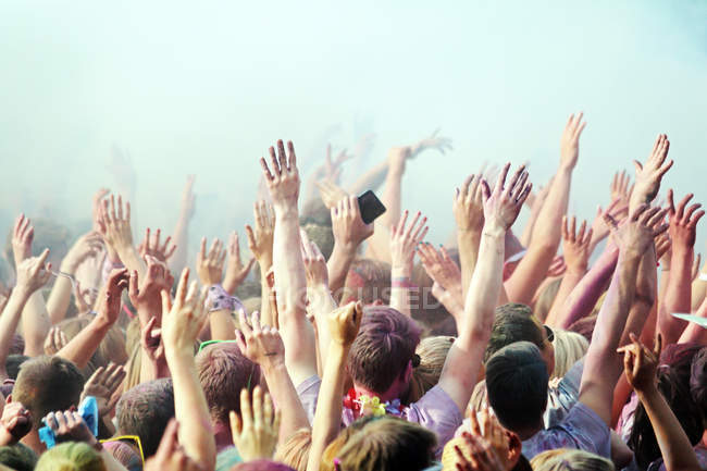 People crowd on a concert  with hands in the air — Stock Photo