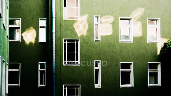 Green house, residential structure with many windows — Stock Photo