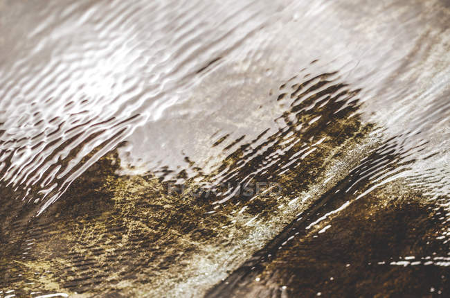 Puddle with reflection on wavy water surface — Stock Photo