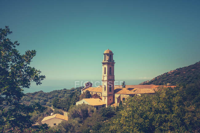 Architecture buildings in mountains, church spire with bell, Corsica France — Stock Photo