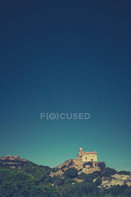 Mountain landscape with church on top hill, Calvi, Corsica, France — Stock Photo