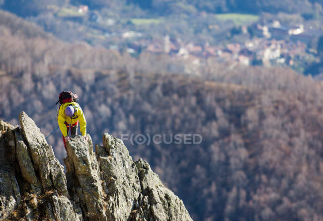 Traveler person climbing on rocky mountain top — Stock Photo