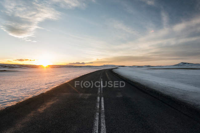 Road through frozen field — Stock Photo