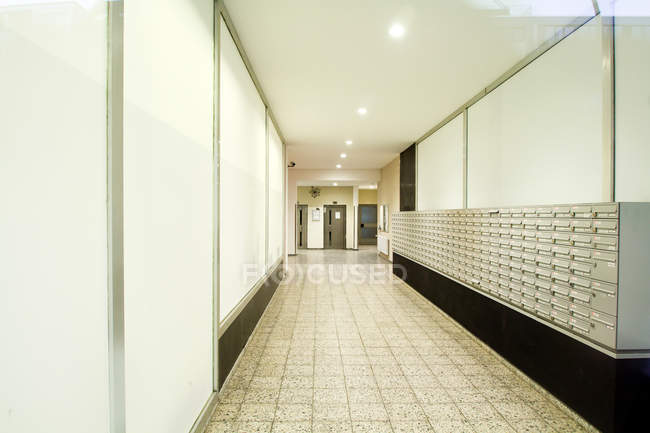 Interior view of empty corridor of modern building with mailboxes — Stock Photo