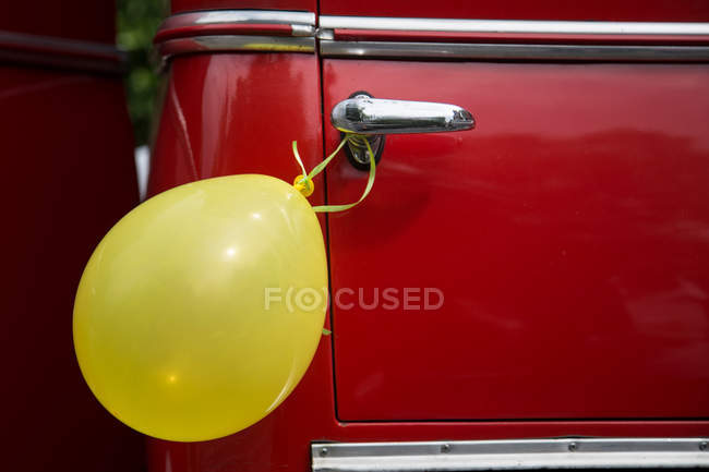 Vintage car door handles Auto Shop Red Vintage Car Door Handle With Yellow Balloon Stock Photo Focused Collection Red Vintage Car Door Handle With Yellow Balloon Partial View