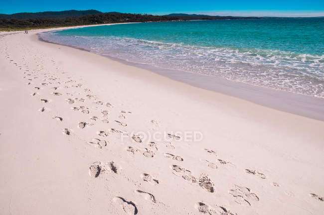 Footsteps at sandy beach — Stock Photo