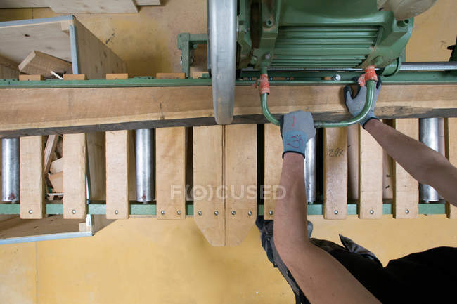 Overhead view of joiner at work by machine — Stock Photo