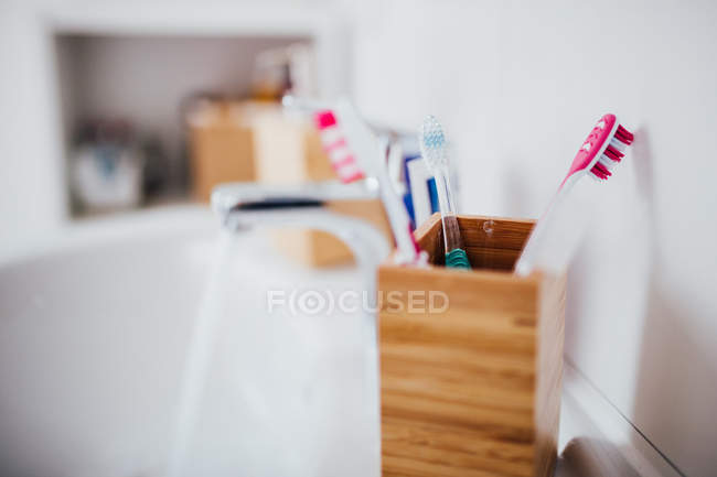 Wooden case with dental toothbrushes — Stock Photo