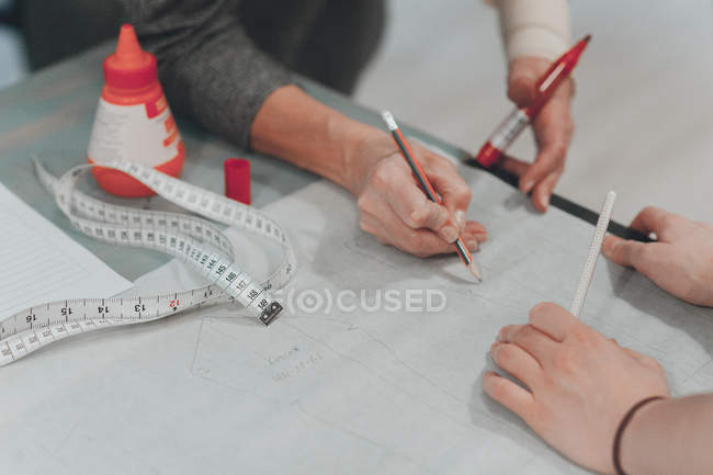 Dressmaker designer working at table with sketch — Stock Photo
