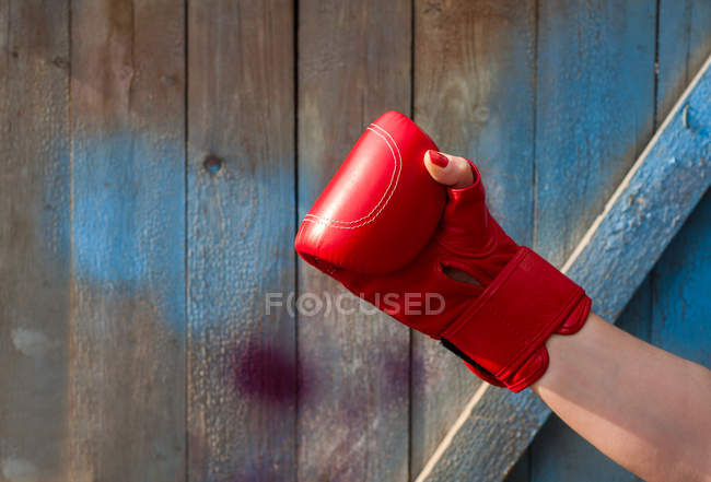 Red leather boxing glove on hand — Stock Photo