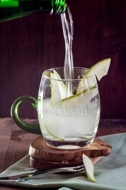 Close-up of pouring drink into glass — Stock Photo
