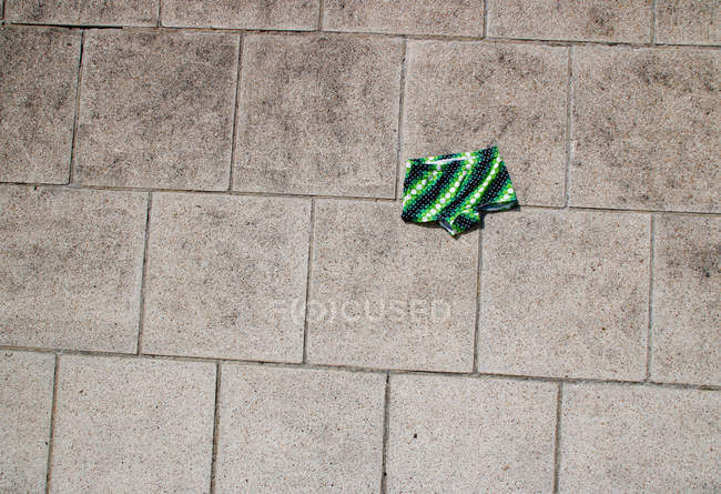 Swimming trunks on street ground paved with cobble stones — Stock Photo