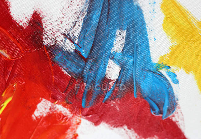 Colorful brush strokes on white canvas — Stock Photo
