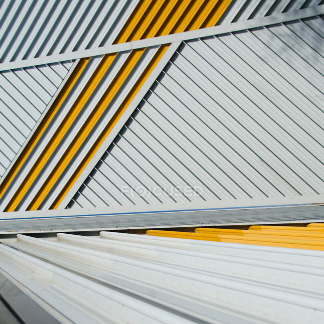Gray surface with yellow stripes — Stock Photo