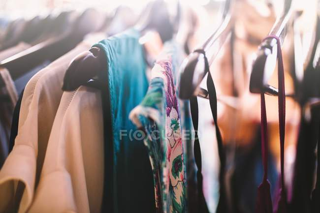 Summer female clothing on handles — Stock Photo