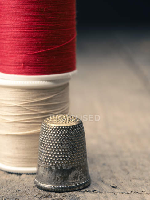 Sewing threads on tailor table — Stock Photo