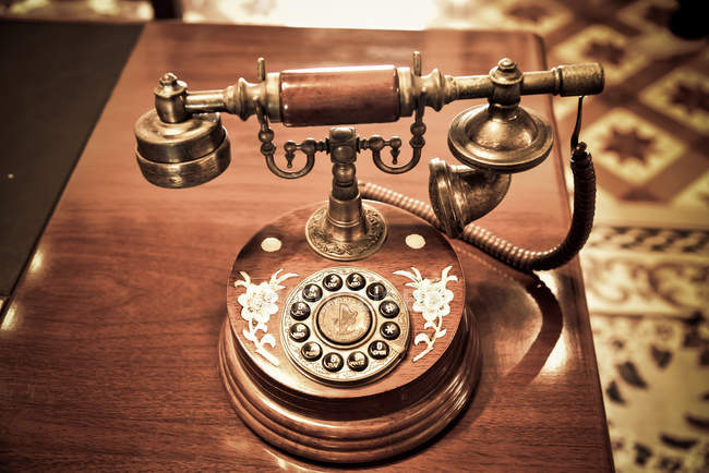 Old fashioned Edison telephone with rotary dial on wooden table — Stock Photo