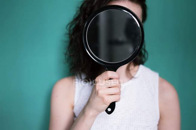 woman holding hand mirror pure hand woman holding and covering face with hand mirror stock photo head