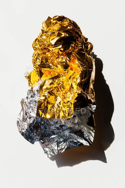 Shiny golden crumpled paper — Stock Photo