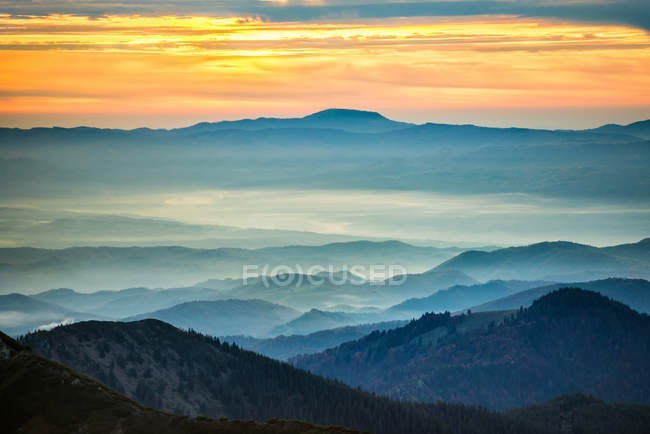 Blue mountains and hills under sunset — Stock Photo