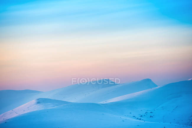 Landscape with sunset over hills — Stock Photo