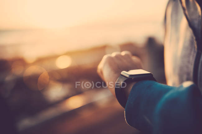Man using his smart watch — Stock Photo