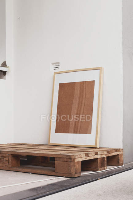 Home interior design, picture frame on wooden pallet — Stock Photo