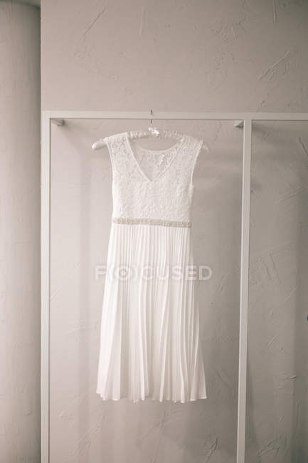 Hanging white dress in shop — Stock Photo