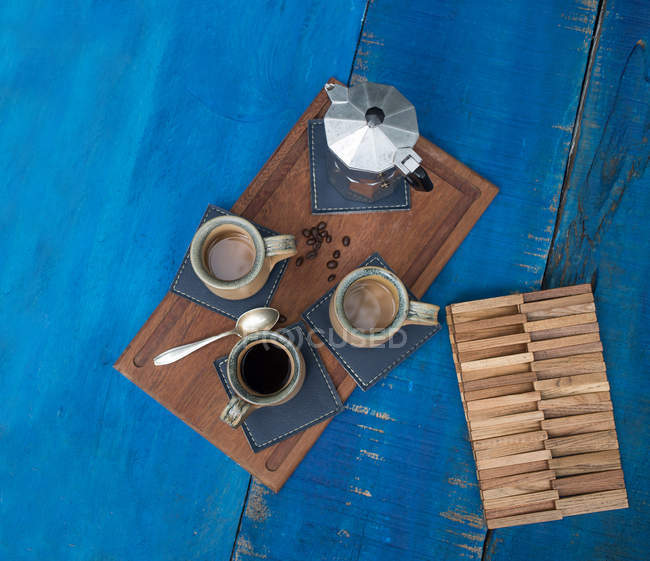 Top view of espresso set on blue wooden table — Stock Photo