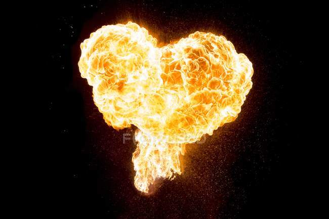 Fire burning in the heart shape — Stock Photo