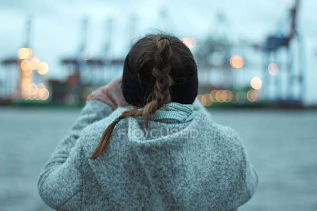 Woman outdoors in warm coat and pigtail hairstyle — Stock Photo