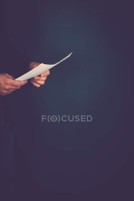 Close-up view of person hands holding paper sheet — Stock Photo