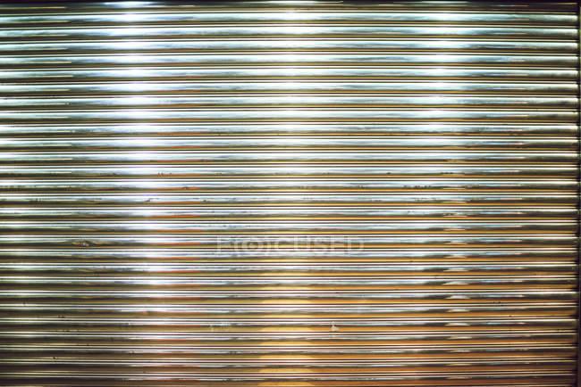 Shiny silver metallic rolling shutter — Stock Photo