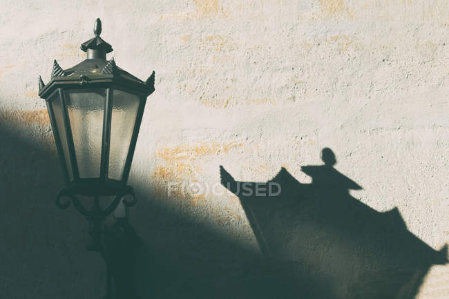 Lantern view on wall and its shadow — Stock Photo