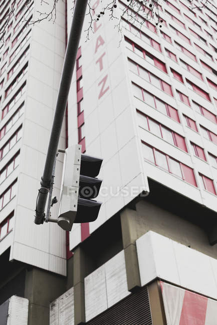 High rise building facades of modern architecture and street light, bottom view — Stock Photo