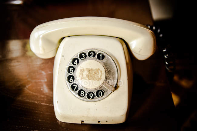 Close-up view of vintage telephone on table — Stock Photo
