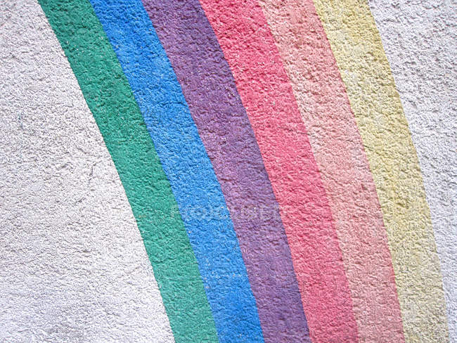 Wall colored in rainbow paint — Stock Photo